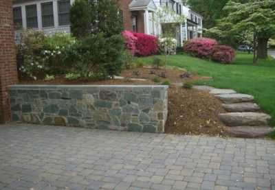 Stone driveway with stone wall and steps