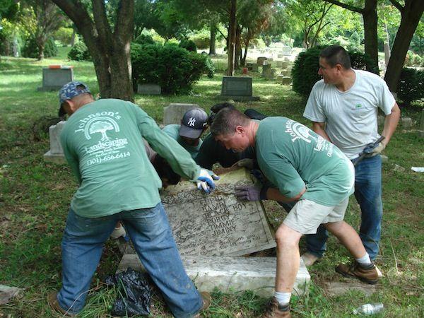 landscape stuff repairing a gravestone