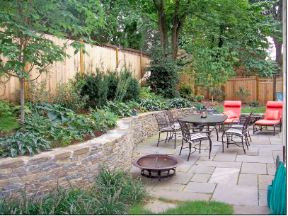 patio table and chairs near a stone wall
