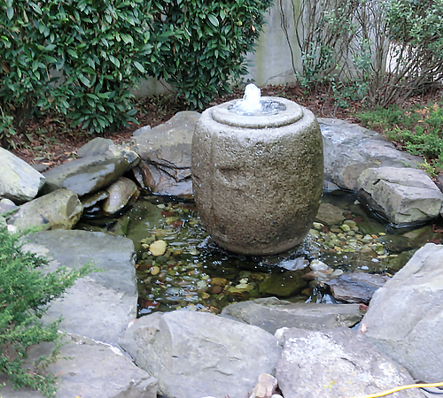 Outdoor stone fountain water feature