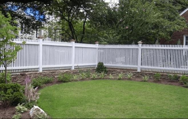 White fence surrounding yard