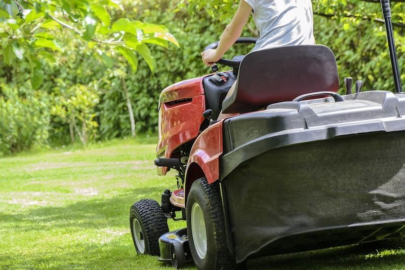 Seated lawn mower