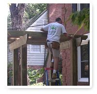 Man working on wooden structure