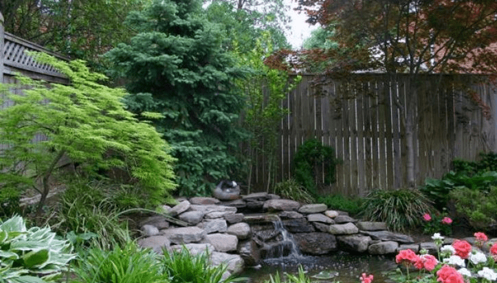 Stone wall with waterfall and pond