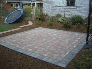 Small stone patio in backyard