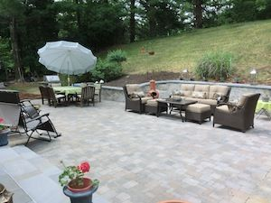 Large outdoor stone patio with outdoor seating and tables