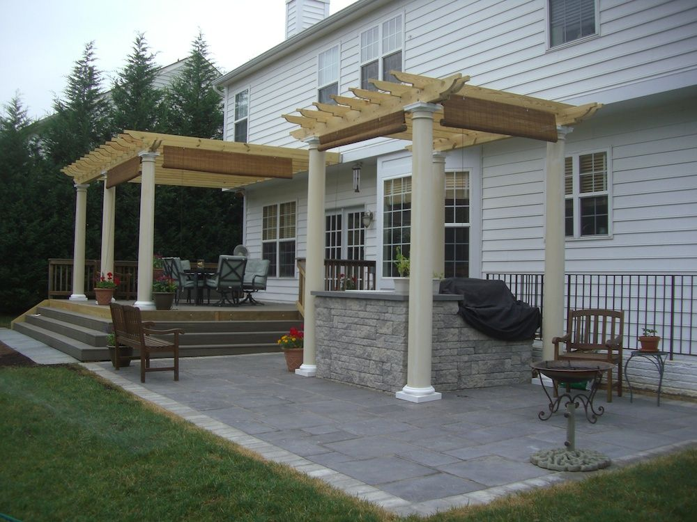 Patio with sheltered hot tub and table