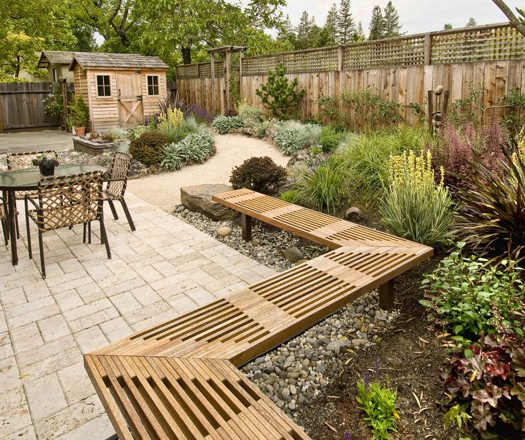 Patio with bench and wooden shed