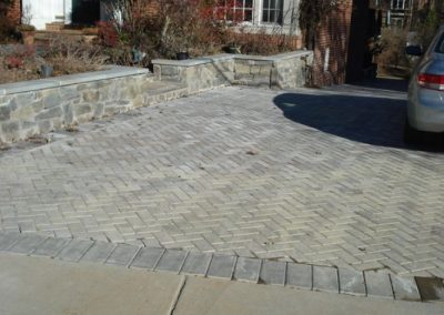 Stone paved driveway in front of house