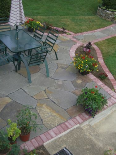 Backyard paved patio area with sitting area