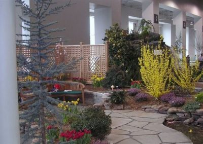Indoor landscaped area with plantings and seating area