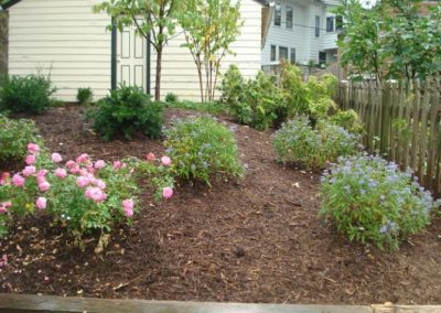 Yard with mulch, plantings, and flowers