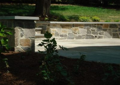 Stone retaining wall in driveway