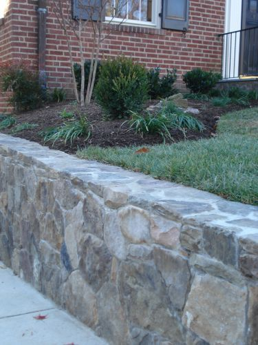 Stone retaining wall in front lawn