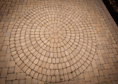 Stone pavers arranged in circular pattern on paver drive