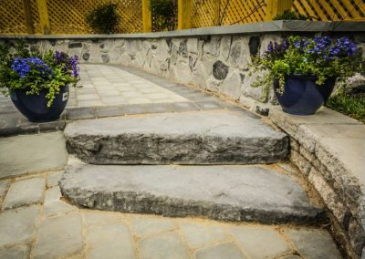Stone stairs on stone patio
