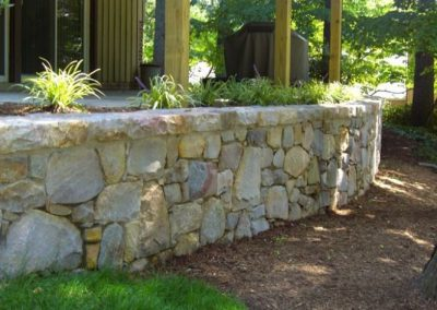 Stone retaining wall in backyard