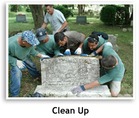 Landscape workers cleaning up a gravesite