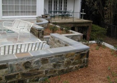 Stone retaining walls in back patio