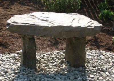 Stone bench on gravel
