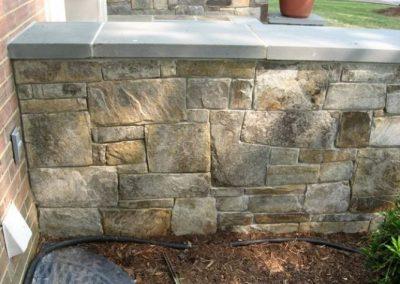 Stone retaining wall outdoors