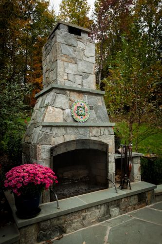 Light gray stone outdoor fireplace