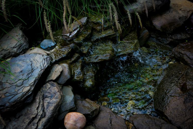 Dark stone outdoor water feature