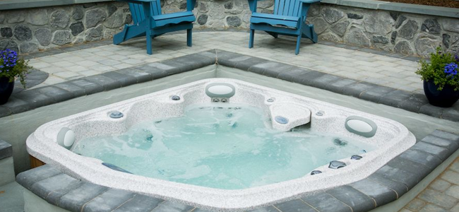 Stone patio with hot tub