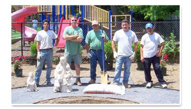 Johnson Landscaping team standing together in a group