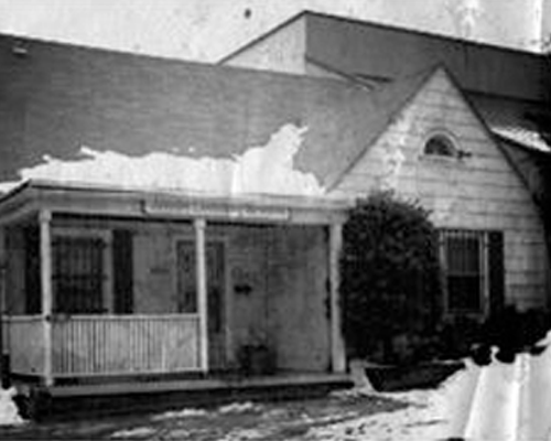 Old black and white photo of a home