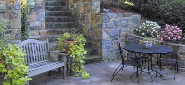 Flagstone patio next to stone stairway