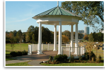 Ornate gazebo in large green area