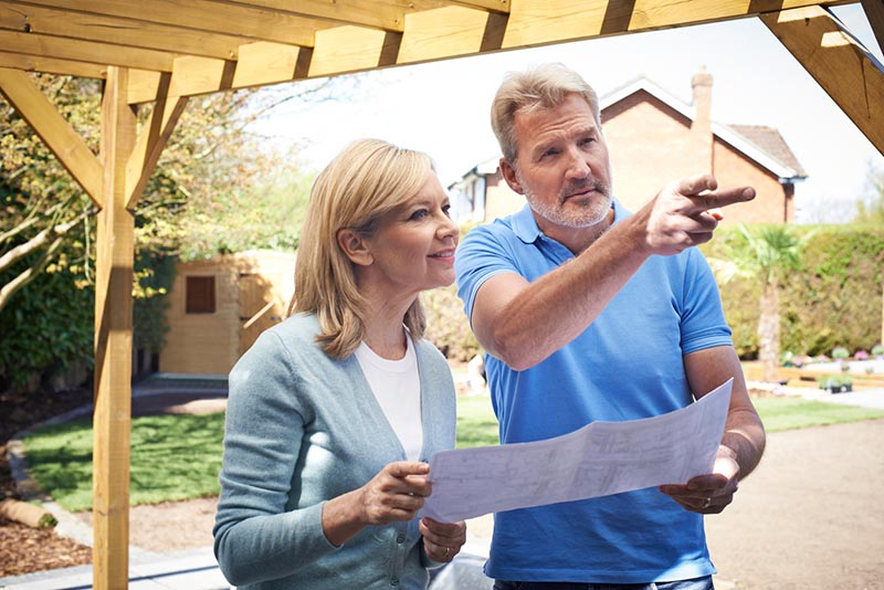 Woman and man discussing landscaping project