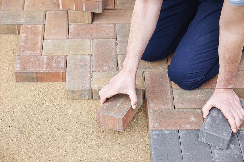 Main installing landscape pavers