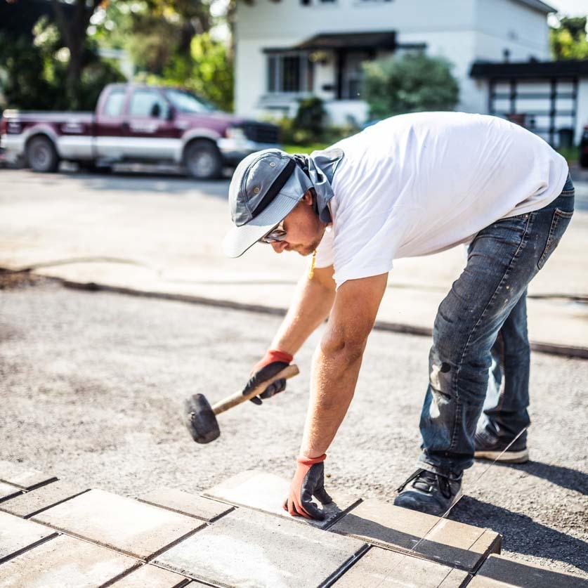 Landscaper installing pavers