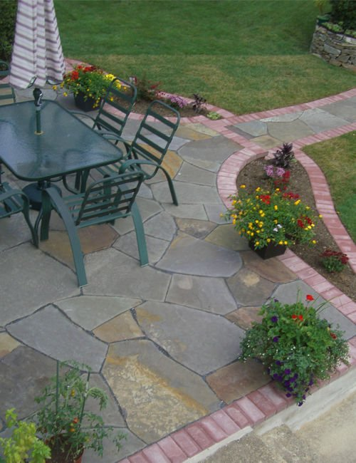 Flagstone patio with chairs and a table