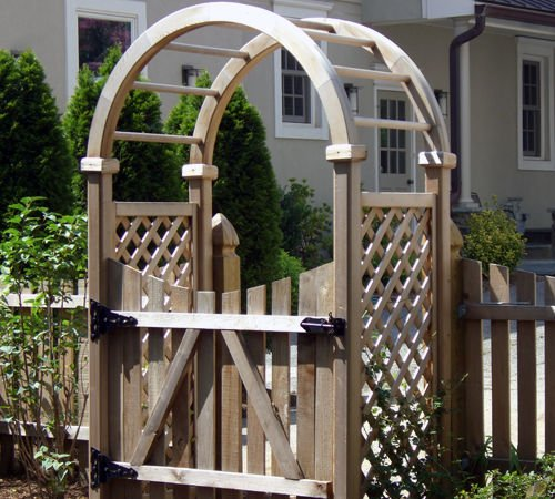 Wooden arbor in front of home