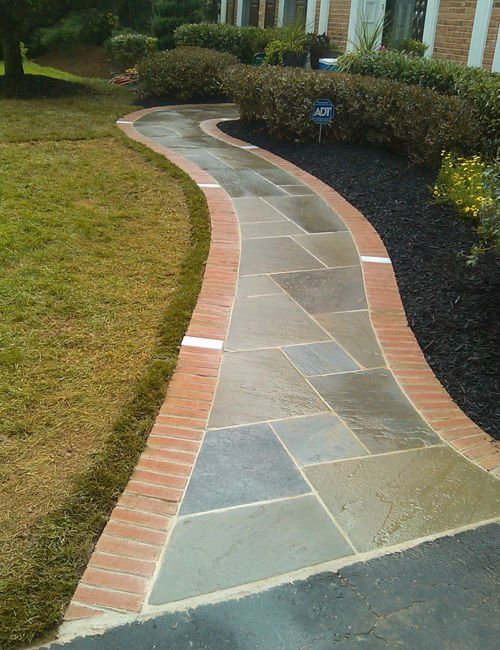 Flagstone walkway leading to the front entrance of a home