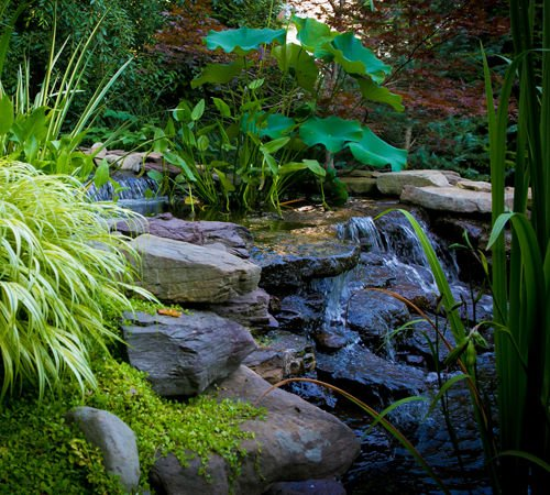 Outdoor stone waterfall water feature