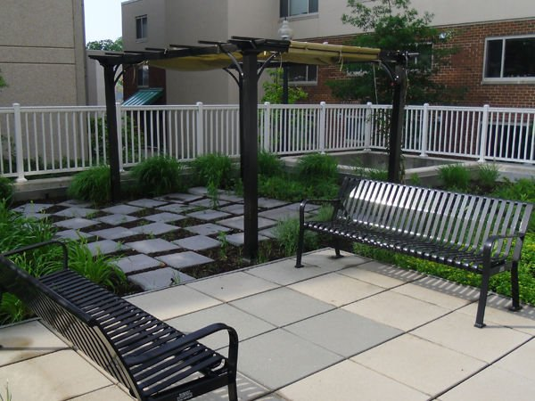 Metal benches on a flagstone patio