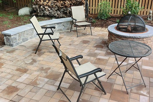 table and chairs on a patio backyard